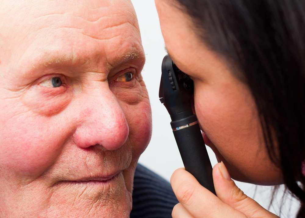Man with Cataracts getting his eyes looked at.